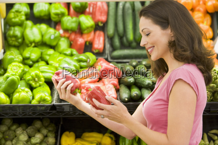 woman shopping for bell peppers at