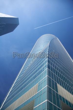 airplane between skyscrapers