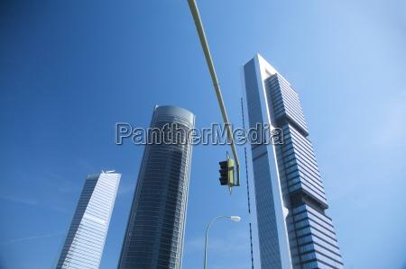 skyscraper lamppost and traffic lights