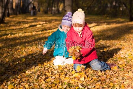 children throw autumn leaves 4