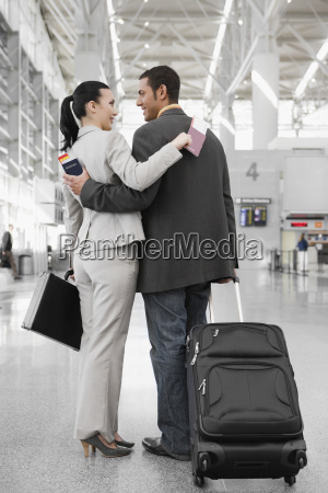 businessman and a businesswoman standing at