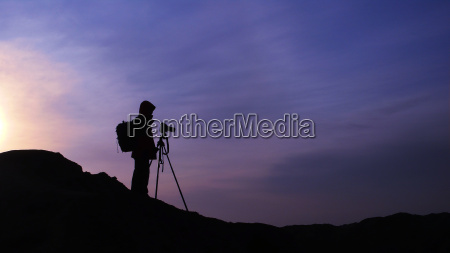 silhouette of a photographer at sunrise