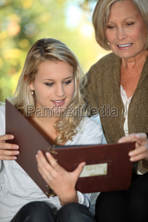 young woman and her grandmother looking