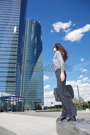 two skyscrapers and businesswoman