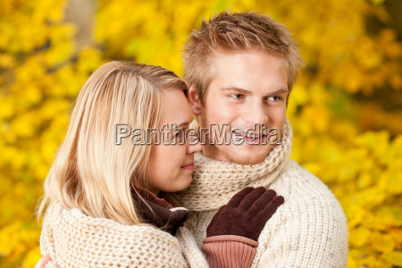 autumn happy couple hugging together park