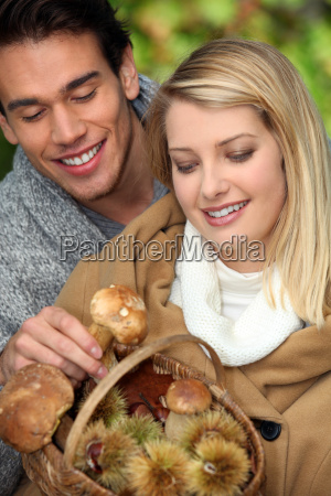 young couple with basket full of