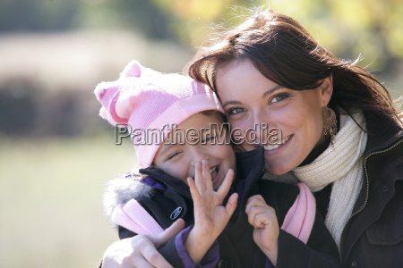 mother and daughter outside on a