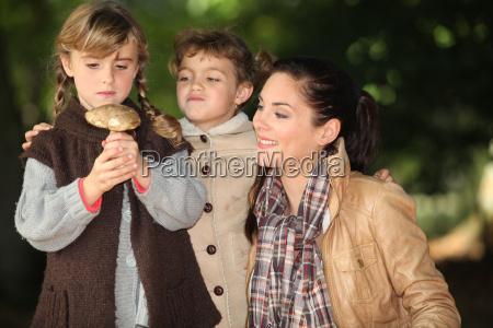 girl holding wild mushroom