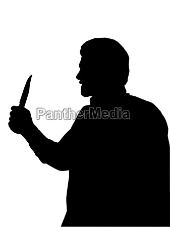 silhouette of man holding knife