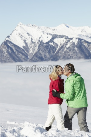 couple admiring mountain view whilst on