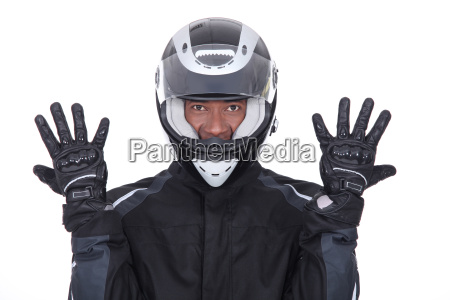 motorcyclist wearing black jacket gloves and