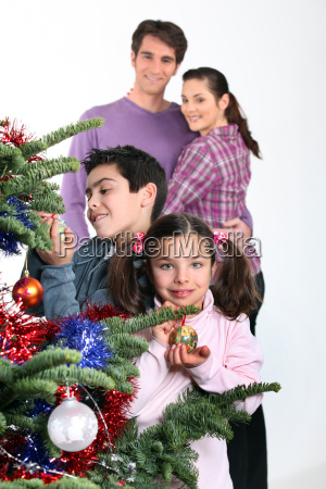 family gathered around christmas tree