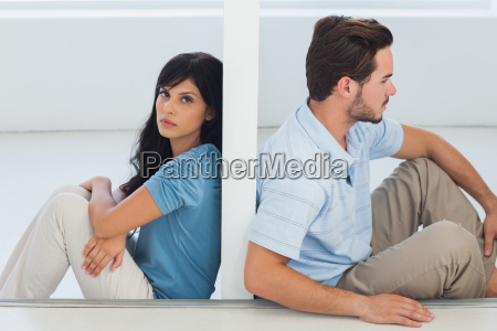 sitting couple are separated by wall