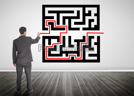 businessman drawing a red line through