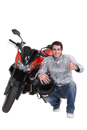 man with motorbike and helmet
