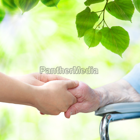 senior woman in wheel chair holding