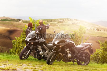 two motorcyclists enjoy the view in