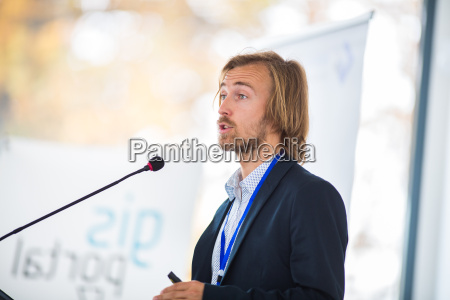 handsome young man giving a speech