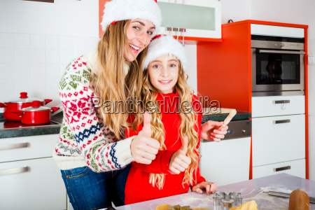family bakes cookies in the kitchen
