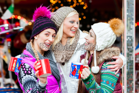 friends drinking mulled wine at christmas