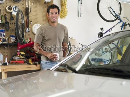man repairing bicycle on workbench in