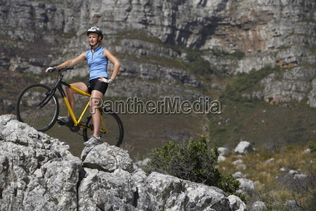 female mountain biker sitting on bicycle