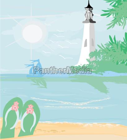 lighthouse seen from a tiny beach