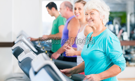 group with seniors at treadmill fitness
