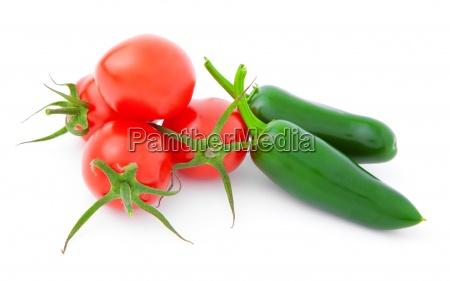 jalapeno pepper and tomatosisolated on white