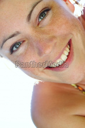 young woman smiling at camera in