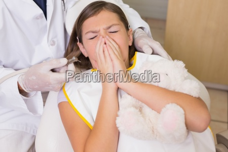 pediatric dentist trying to see sneezing