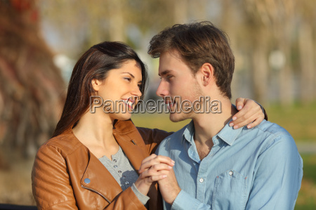 couple hugging and dating in a