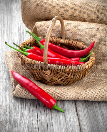 chili peppers in wicker basket wooden