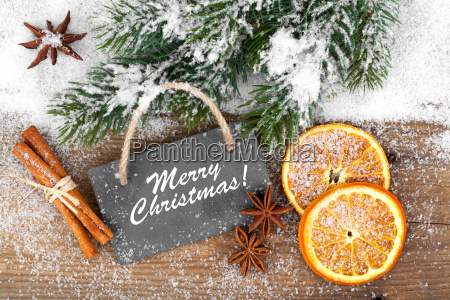 slate and christmas spices on wooden
