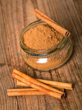 cinnamon in glass with cinnamon stickson