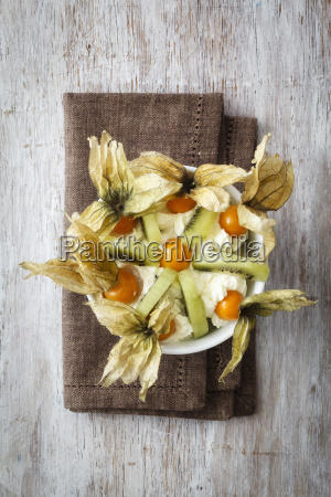 wholefood dish with kiwi physalis and