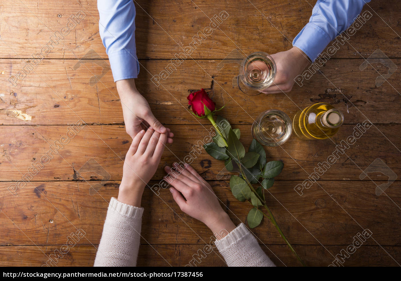 hands, of, a, young, couple, with - 17387456