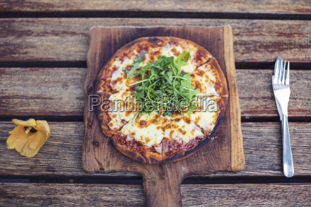pizza on chopping board