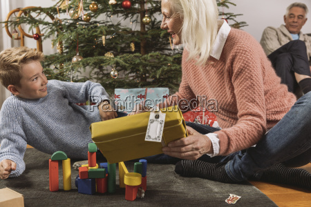 grandmother giving her grandson a christmas