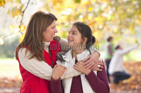 mother with arms around daughter in