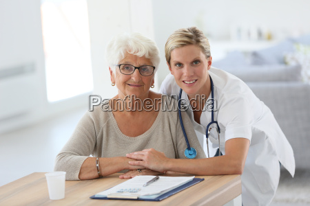 portrait of young nurse with elderly