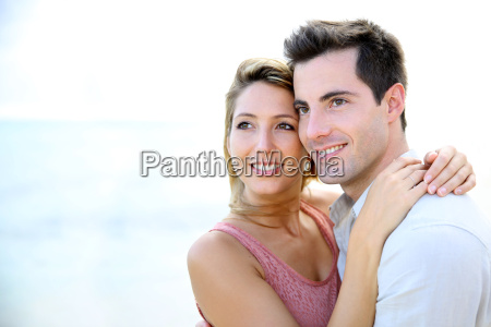 in love couple embracing by the