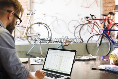 a man in a bicycle repair