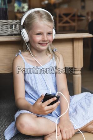 portrait of happy little girl listening