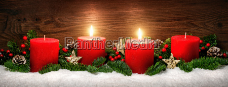 advent decoration with two candle flamessnowfir
