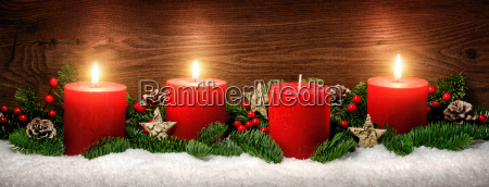 advent decoration with three candle flamessnowfir