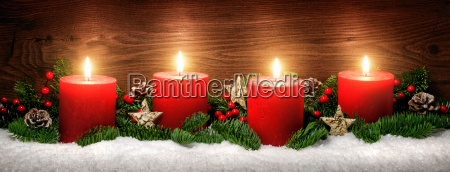 advent decoration with four candle flamessnowpine