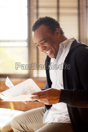 man posing with charismatic smile and