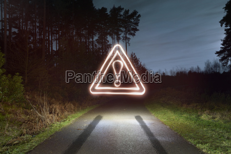 tyre skid marks and glowing road