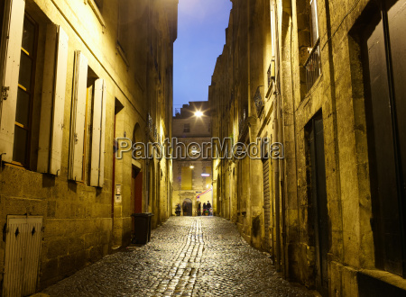 cobbled street at night bordeaux france